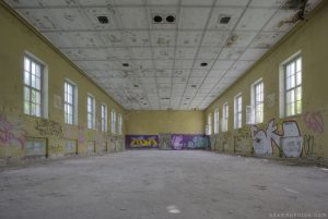 Adam X Urbex Urban Exploration Abandoned Germany Wunsdorf barracks soviet corridor large room graffiti