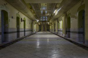 Downstairs ground floor dark night lighting lights still on green Prison H19 Germany Deutschland Urbex Adam X Urban Exploration Access 2016 Abandoned decay lost forgotten derelict