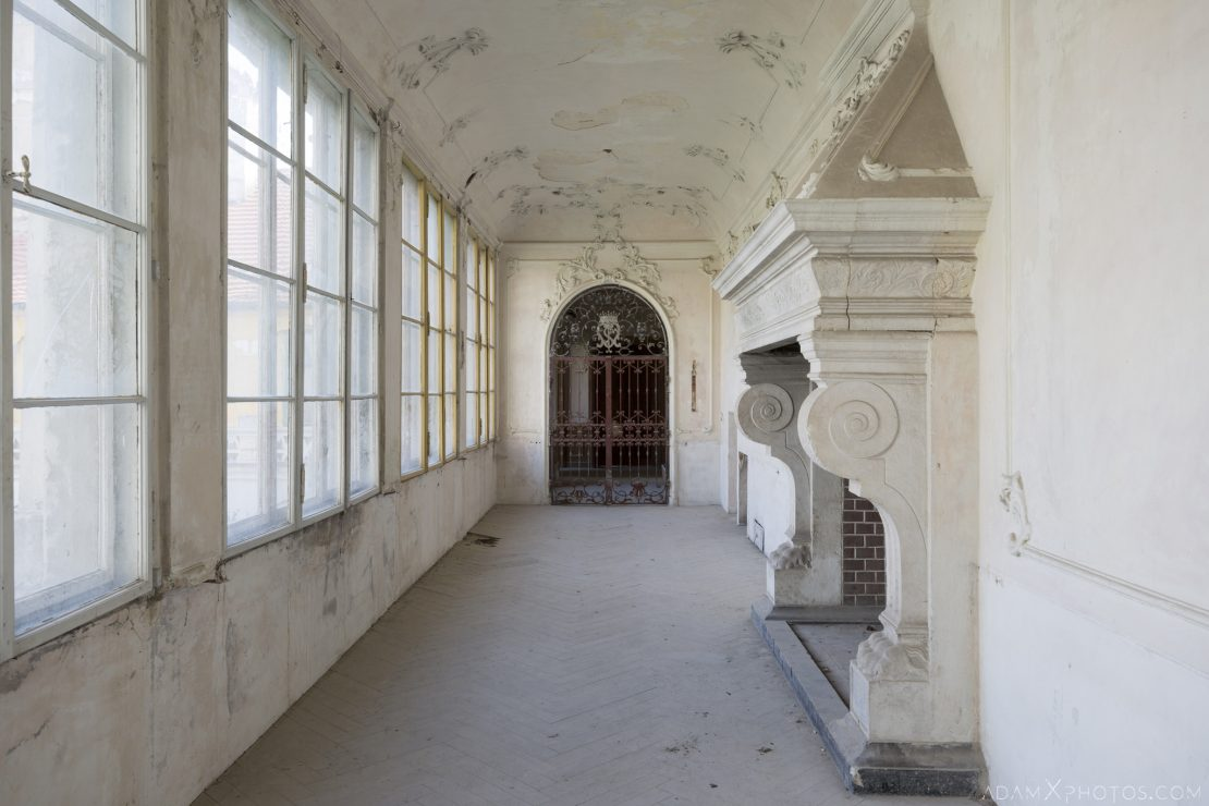 Hallway corridor large stone fireplace Palac w Zyrowej Urbex Poland Adam X Urban Exploration Permission Visit Access 2016 Abandoned decay lost forgotten derelict location haunting eerie