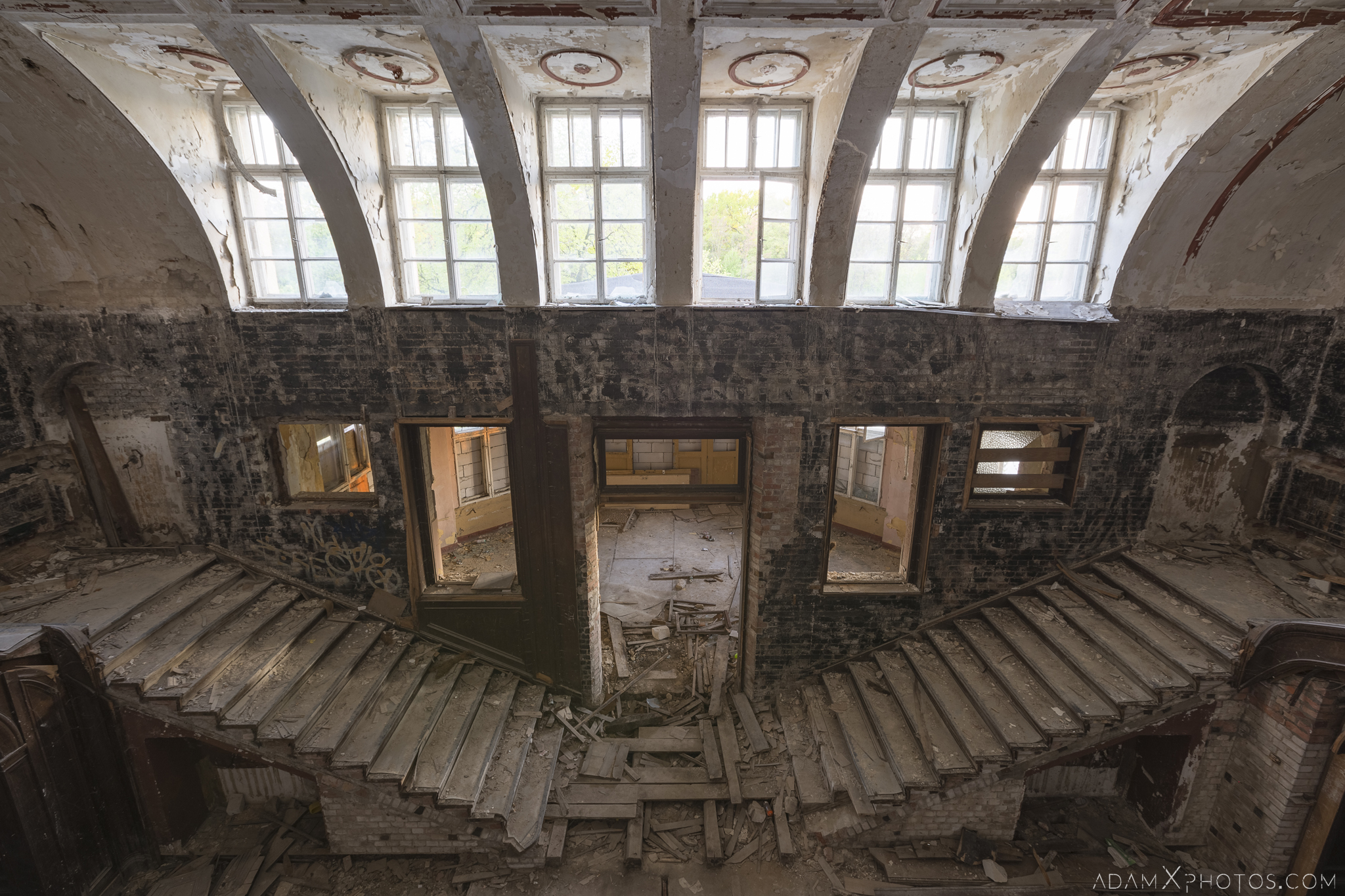 View from balcony looking down Main hall twin split stairs staircase Great Belcz Palace Pałac w Bełczu Wielkim Urbex Poland Adam X Urban Exploration Access 2016 Abandoned decay lost forgotten derelict location haunting eerie