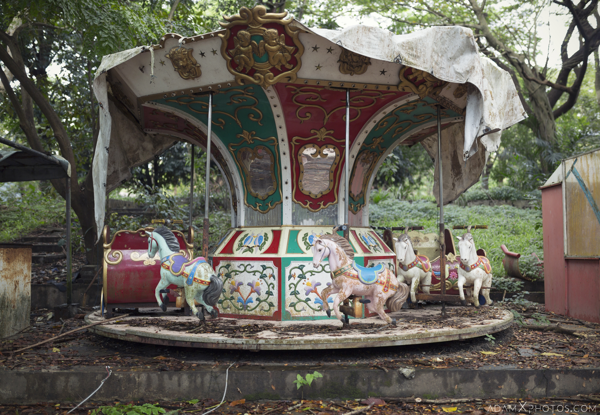 Horses carousel Happy World Theme Park Amusement Park Fairground Myanmar Burma Yangon Rangoon Urbex Adam X Urban Exploration Access 2016 Abandoned decay lost forgotten derelict location creepy haunting eerie