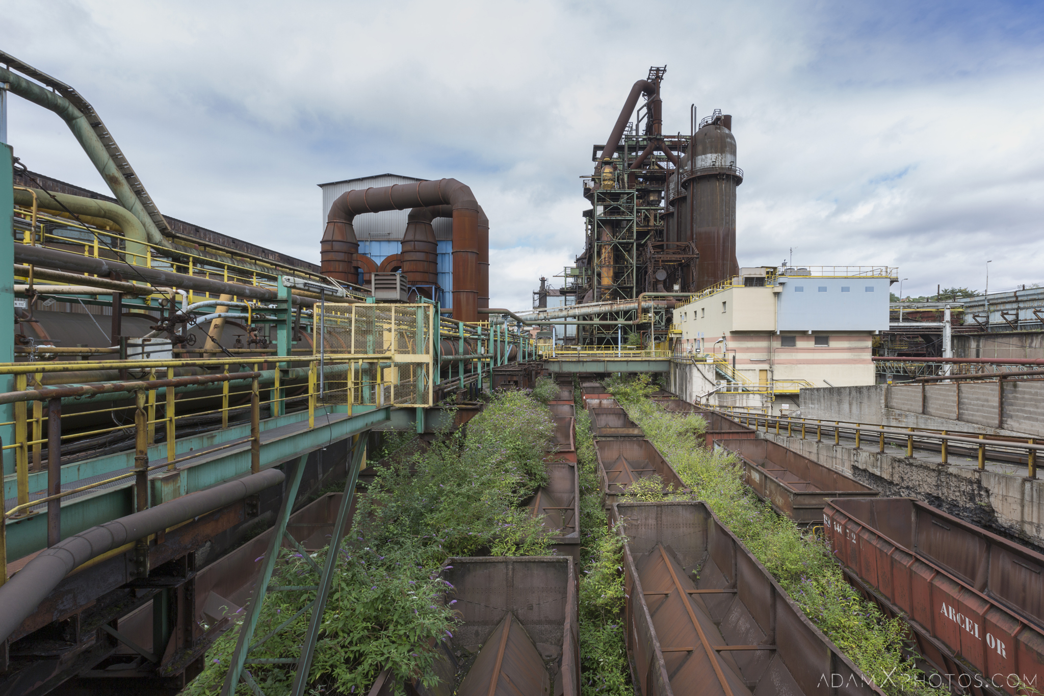 Overgrown railway sidings carriages blast furnace control room bottom of blast furnace P3 HFX Florange Hayange ArcelorMittal blast furnaces steel works plant Industrial Industry Adam X Urbex Urban Exploration France Access 2017 Abandoned decay lost forgotten derelict location creepy haunting eerie