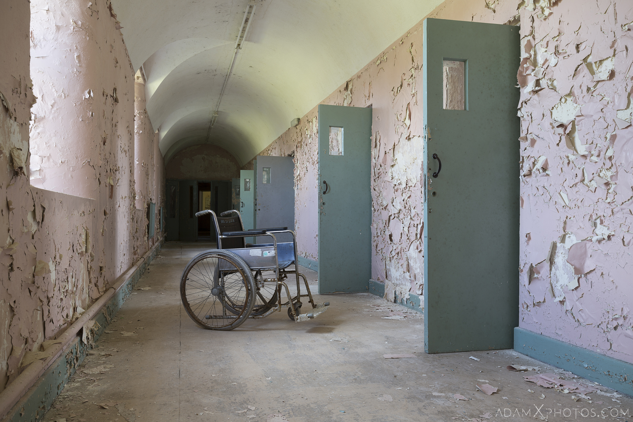 wheel chair peeling paint corridor cells Connacht District Lunatic Asylum St Brigid's Hospital Adam X Urbex Urban Exploration Ireland Ballinasloe Access 2017 Abandoned decay lost forgotten derelict location creepy haunting eerie