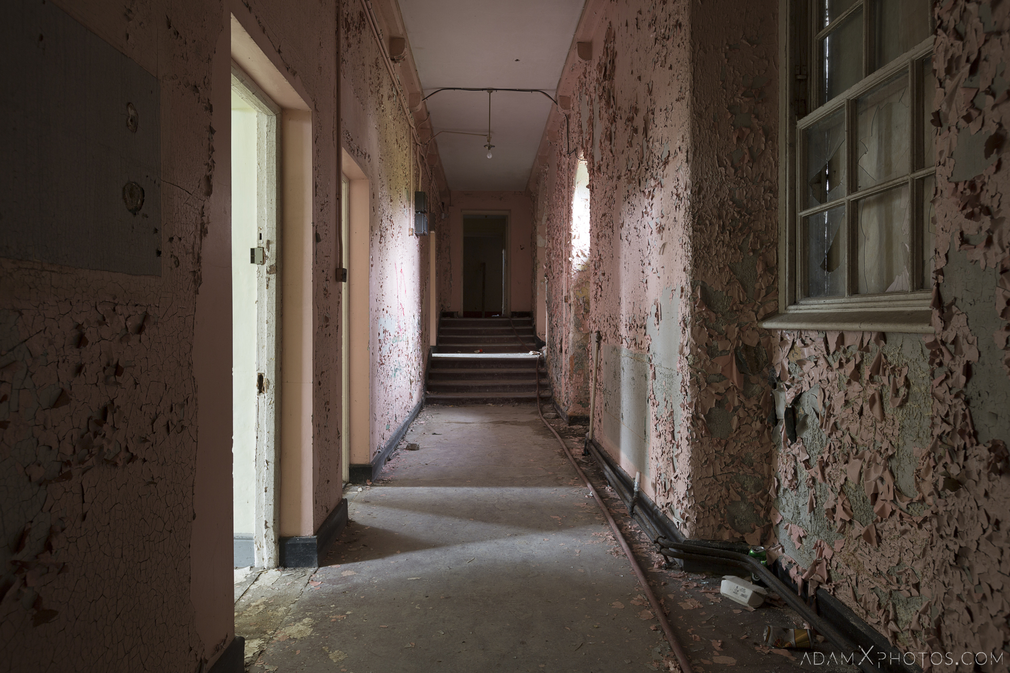 Pink peeling paint corridor Ennis District Lunatic Asylum Our Lady's Hospital Ennis County Clare Adam X Urbex Urban Exploration Ireland Ballinasloe Access 2017 Abandoned decay lost forgotten derelict location creepy haunting eerie