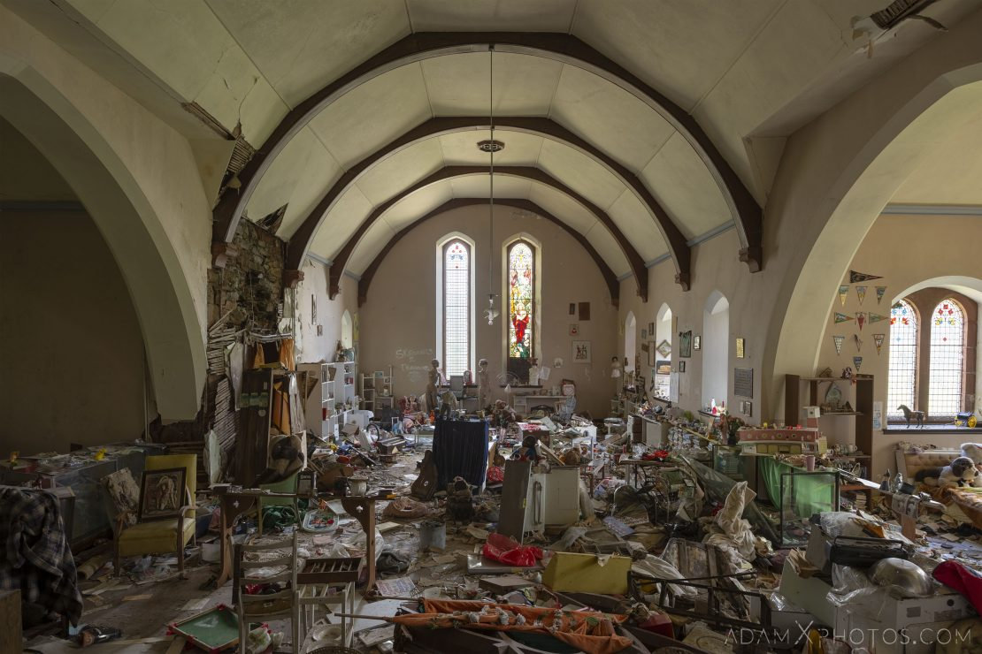 main hall bed soft toys ornaments books stained glass windows Elvanfoot Parish Church Hoarder Hoarders Church Adam X Urbex Urban Exploration Access 2018 Abandoned decay lost forgotten derelict location creepy haunting eerie