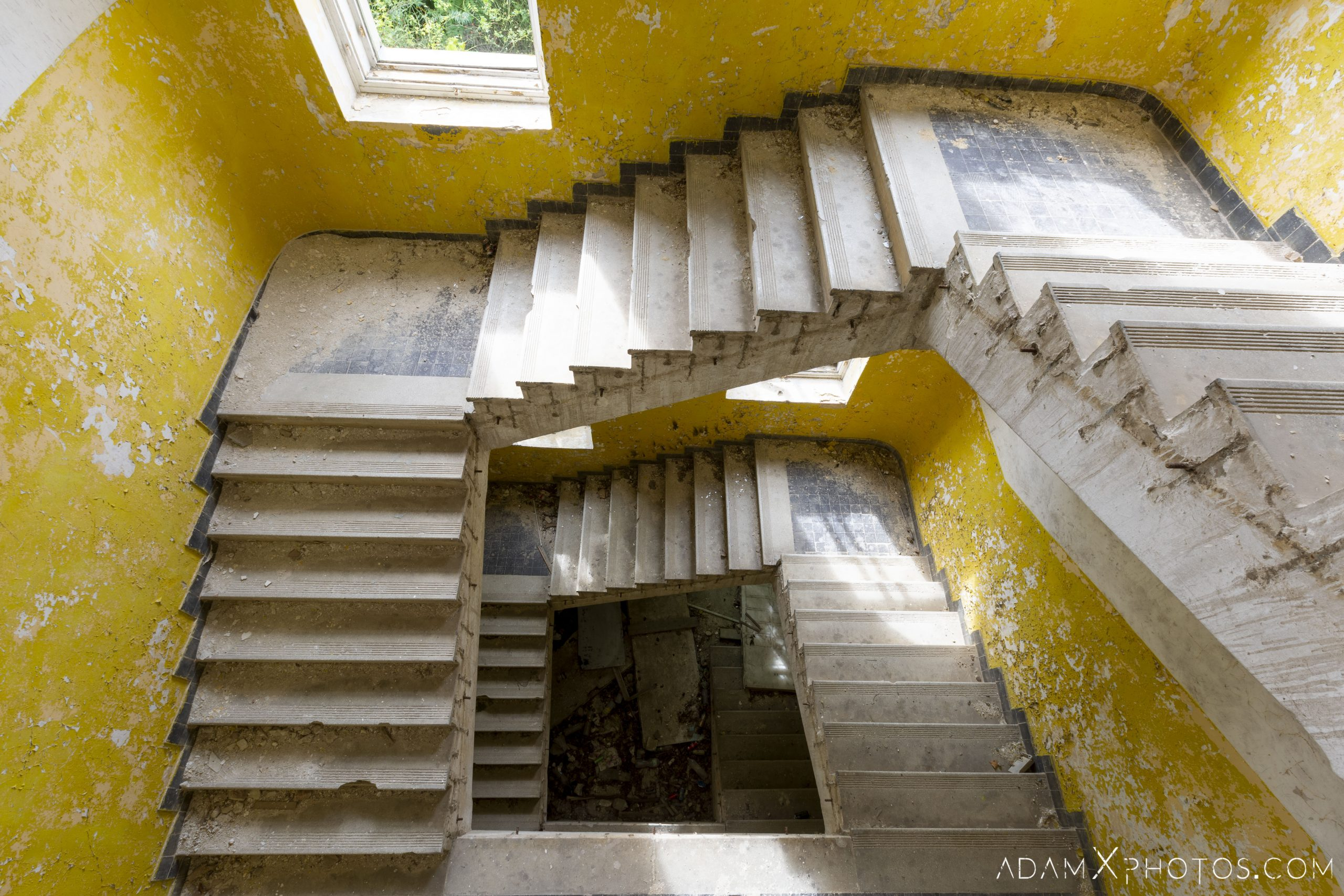 Looking down yellow staircase stairs stairwell Hajmaskér Barracks Hungary Adam X Urbex Urban Exploration Access 2018 Abandoned decay ruins lost forgotten derelict location creepy haunting eerie