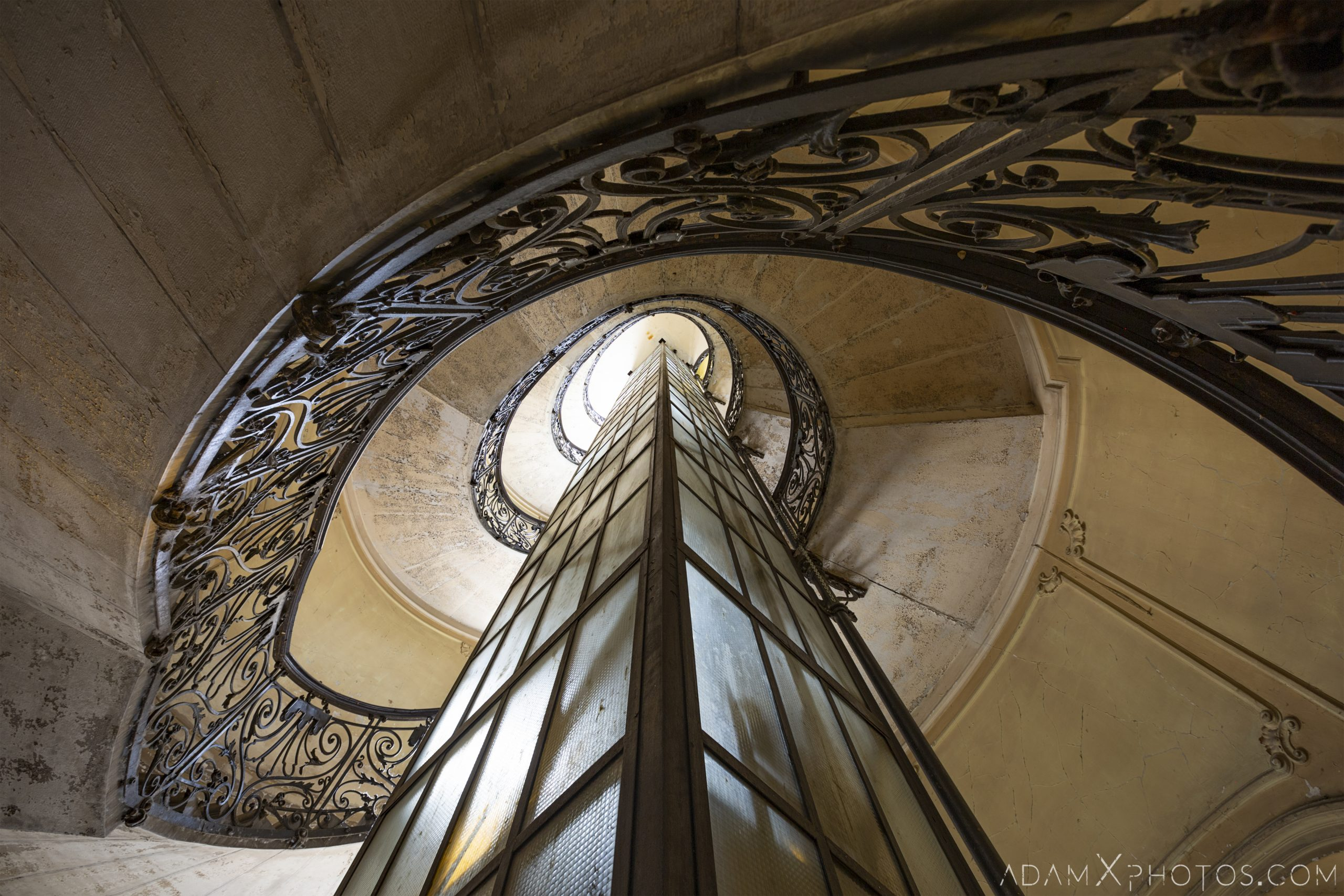 spiral staircase looking up lift Adria Palace Budapest Hungary Adam X Urbex Urban Exploration Access 2018 Blade Runner 2049 Abandoned decay ruins lost forgotten derelict location creepy haunting eerie security ornate grand neo baroque