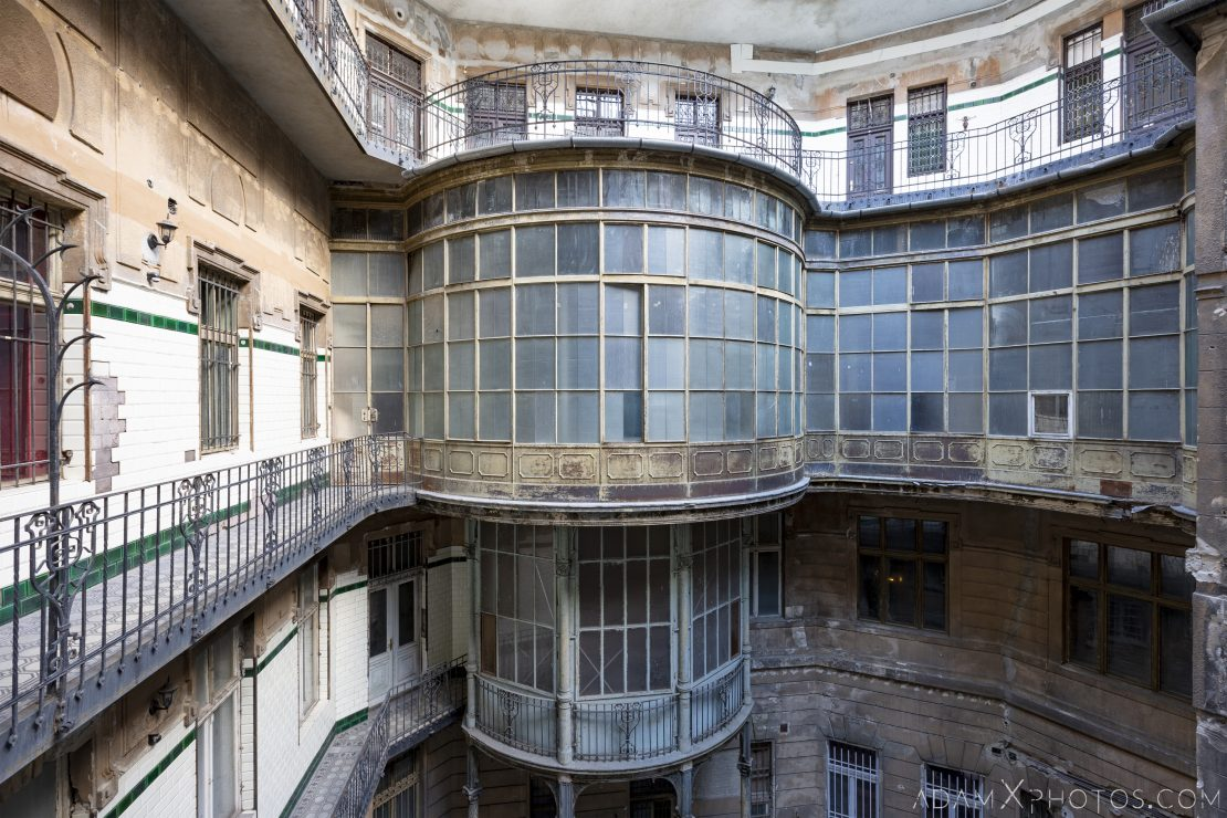 exterior outside railings Curved walkway balcony windows courtyard Adria Palace Budapest Hungary Adam X Urbex Urban Exploration Access 2018 Blade Runner 2049 Abandoned decay ruins lost forgotten derelict location creepy haunting eerie security ornate grand neo baroque