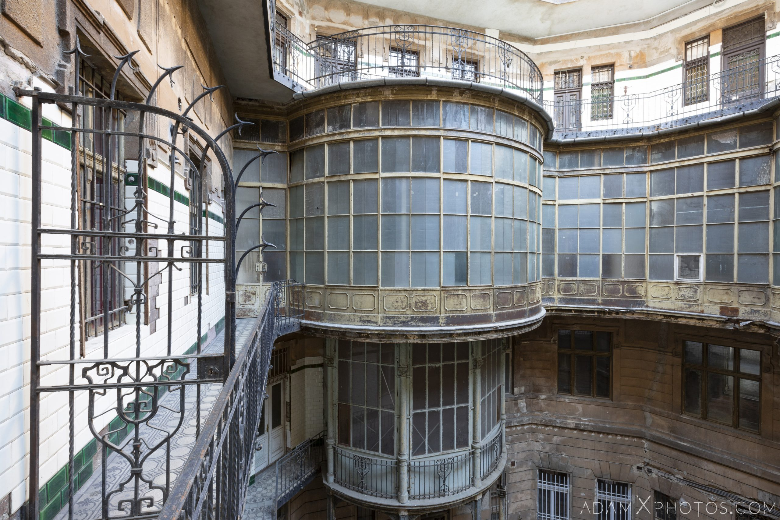 exterior outside railings gate Curved walkway balcony windows courtyard Adria Palace Budapest Hungary Adam X Urbex Urban Exploration Access 2018 Blade Runner 2049 Abandoned decay ruins lost forgotten derelict location creepy haunting eerie security ornate grand neo baroque