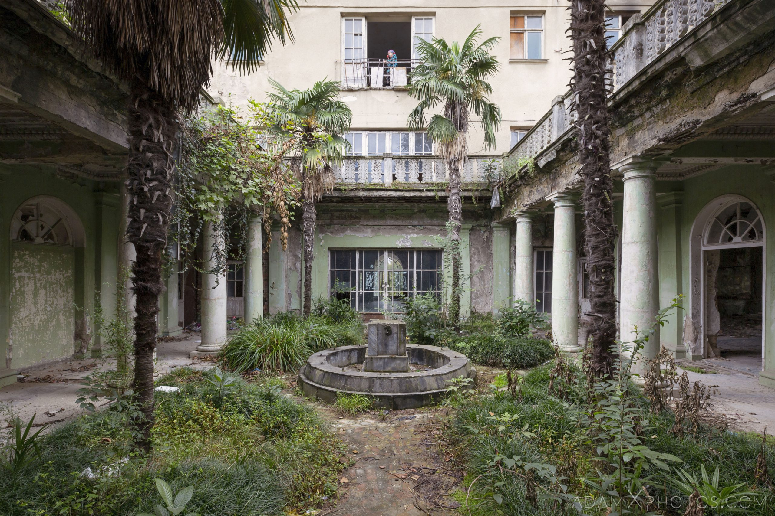 Garden fountain IDPs residents palm trees Green columns central courtyard peeling paint Hotel Tbilisi Tskaltubo Georgia Adam X Urbex Urban Exploration 2018 Abandoned Access History decay ruins lost forgotten derelict location creepy haunting eerie security