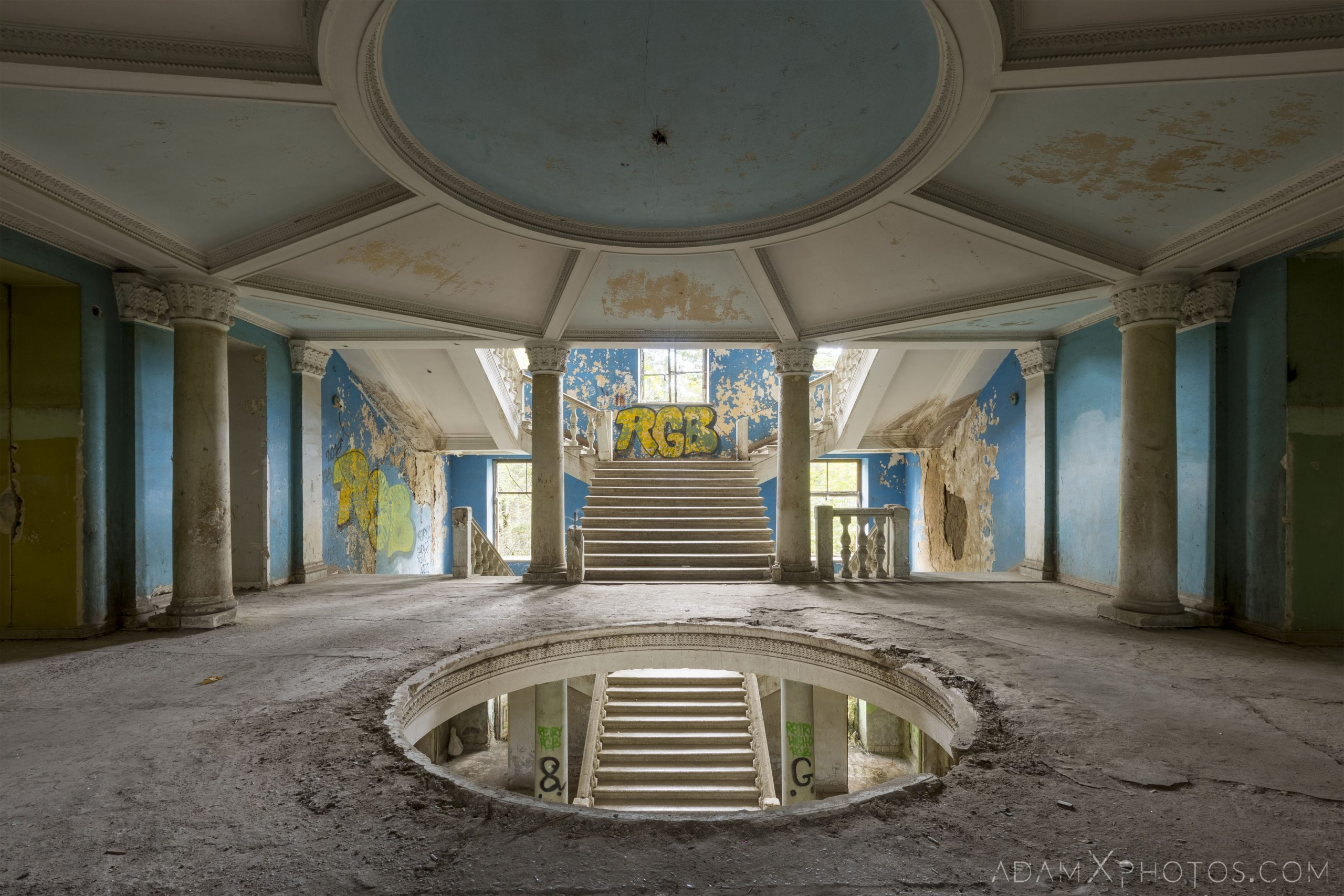 Blue stairs ceiling hole circular graffiti Sanatorium Iveria Tskaltubo Georgia Soviet era Adam X Urbex Urban Exploration 2018 Abandoned Access History decay ruins lost forgotten derelict location creepy haunting eerie security