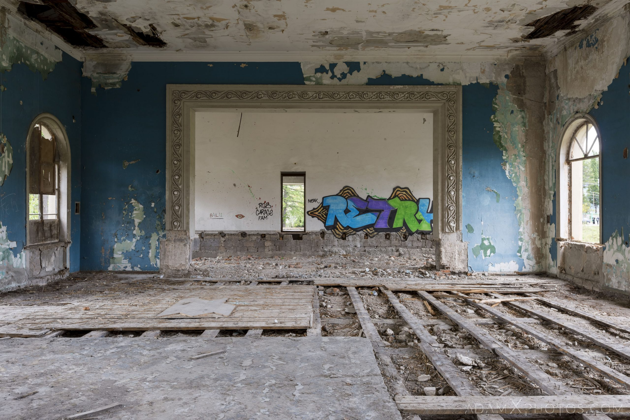 trashed room blue flooring Blue stairs ceiling hole circular graffiti Sanatorium Iveria Tskaltubo Georgia Soviet era Adam X Urbex Urban Exploration 2018 Abandoned Access History decay ruins lost forgotten derelict location creepy haunting eerie security
