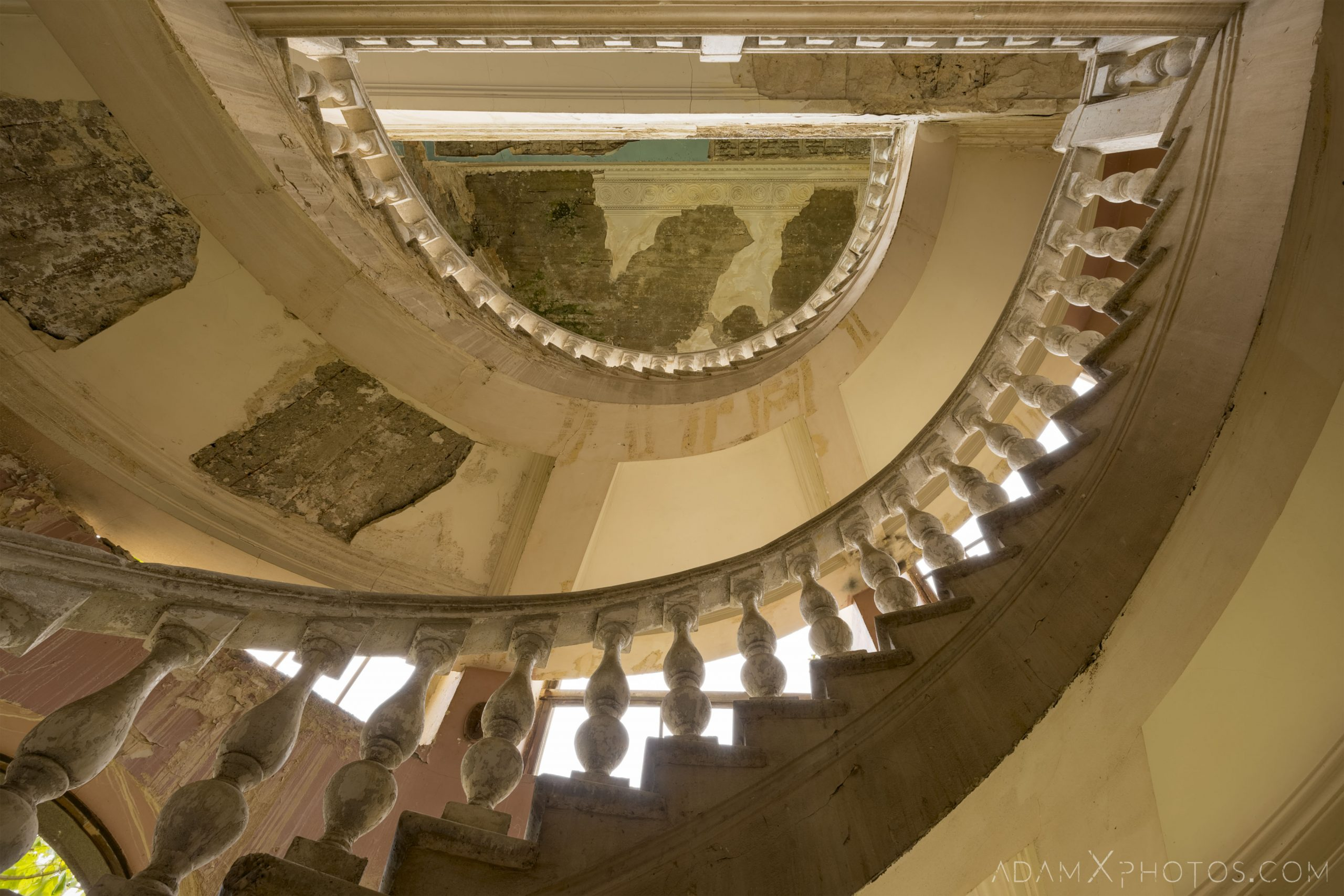 ornate spiral stairs staircase looking up Sanatorium Imereti Tskaltubo Georgia Soviet era Adam X Urbex Urban Exploration 2018 Abandoned Access History decay ruins lost forgotten derelict location creepy haunting eerie security