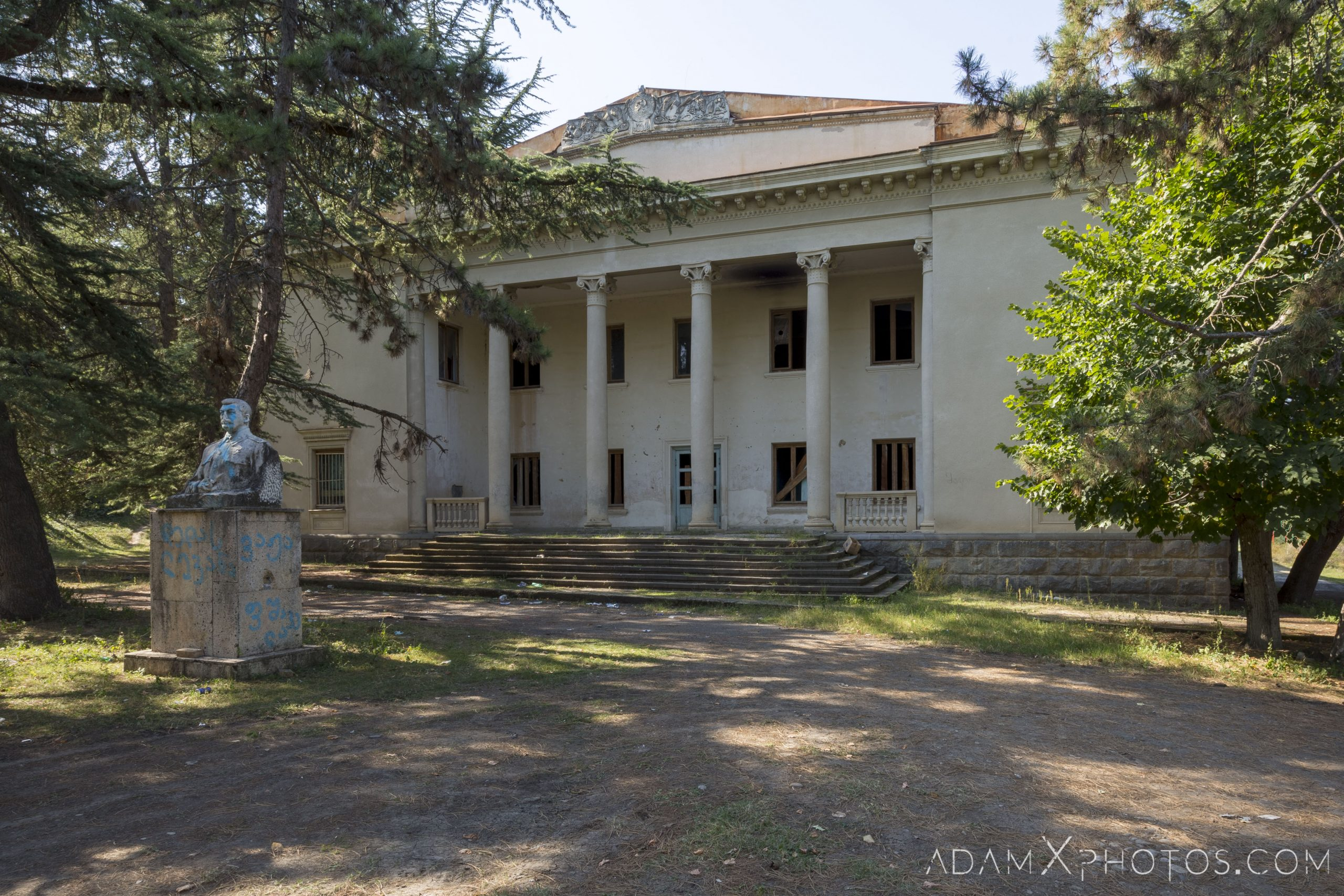 Front outside exterior external statue defaced House of Culture Palace Blue rural Soviet era Georgia Adam X AdamXPhotos Urbex Urban Exploration 2018 Abandoned Access History decay ruins lost forgotten derelict location creepy haunting eerie security